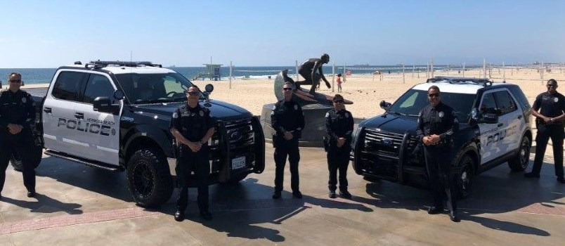 Hermosa Beach Police and vehicles on the beach